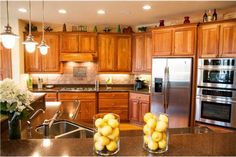 If I can't get rid of the oak cabinets, here is a way to make the kitchen look more updated....