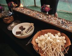 Love this s'mores station for your wedding! View more from this casual pig roast Nashville wedding inspiration from Corky's Ribs & BBQ! | The Pink Bride® www.thepinkbride.com