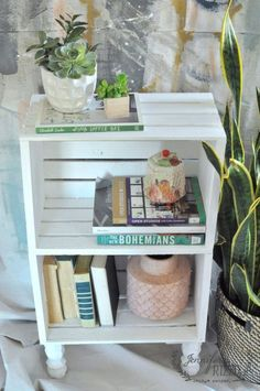 crate side table for easy storage I love this idea of using craft store crates to make a fast and inexpensive side table or book case!I love this idea of using craft store crates to make a fast and inexpensive side table or book case! Deco Theme Marin, Crate Side Table, Diy Side Tables, Wood Crate Table, Farmhouse Side Table, Bed Side Table Ideas, Wood Crate Diy, Pallet Side Table, Rustic Side Table