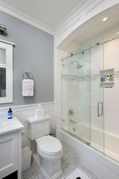 92 best Small Bathroom Designs images on Pinterest in 2018     Girls bath glass Sliding Shower Doors  Transitional  Bathroom  Blue Water  Home Builders   wood trim above tub   soffit may be too heavy of a look