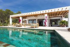 Ibiza villa by Studio COCOON | villa with sea-view at Es Vedra in Ibiza | with Piet Boon by COCOON design taps | exterior design | pool design | terrace furniture | Dutch Designer Brand COCOON