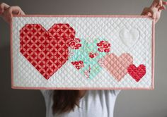 Have you made something to decorate for Valentines day? Aurifill designer Allison Rencher Harris of Cluck Cluck Sew is sharing this lovely free mini quilt pattern on her blog today!  To see more and to download the pattern, please visit: http://cluckclucksew.com/2016/01/i-heart-you-free-mini-quilt-pattern.html