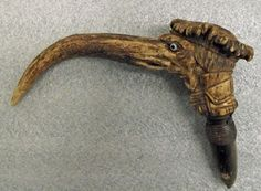 the cane handle is made from elk horn. There are threads at the bottom that would allow the handle to be screwed onto a cane. When removed, another hole appeared, and the handle could become a pipe. Dog Skeleton, Creepy Images, Cane Handles, Screw It, Religious Images, Bone Carving, Museum Collection, Elk, Horn