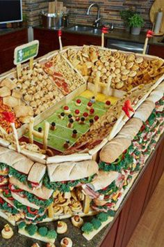 Super Bowl Feast ! What a party platter ! Super Bowl / Football Stadium Made of SUBS , CHIPS , CHEESY POOFS , and lots of other stuff :)
