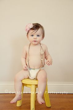 One year old wearing old jewelry not broken that would be dangerous but it a great way to recycle old jewelry.  Too cute.