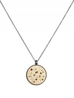 droplet hammered pendant with semi-precious stones in mixed shapes