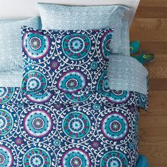 Darah Back-To-Campus Percale Duvet Cover / Sham - Suzani medallions spin across this duvet cover's textural navy ground in exuberant shades of aqua, sky, pink, green and white. A fun way to enliven your dorm bed, the Darah Duvet Cover layers beautifully with our Simi Back-to-Campus sheets, sold separately.