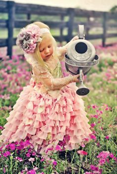 Oh my!  Precious baby girl. She, too, is a flower in a garden of flowers.