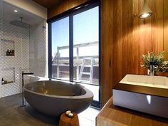 """Kyle and Kara's """"perfect"""" bathroom on The Block. Totally loving the Blackbutt timber in combination with the glass and concrete. #blackbutt timber #bathroomdesign #theblock2014"""