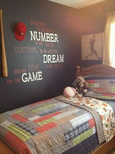 with floor-length blue curtains and red and navy bedding, this