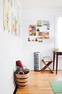Chris Lynn's Sunny & Simple Austin Abode House Tour | Apartment Therapy | Love the photos on the wall with wire + clips
