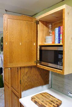 Microwave  hidden in cabinet.