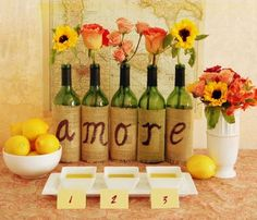 Wine bottle decor and flowers for Tuscan bridal shower theme.Love instead of Amore for a non themed bridal shower Italian Bridal Showers, Italian Themed Parties, Spanish Themed Party, Wine Bottle Crafts, Wine Bottles, Wine Decanter, Wine Parties, Bridal Shower Decorations, Italian Party Decorations