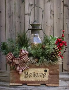This gorgeous piece is featured in the Country Sampler Magazine! Reclaimed barn wood box black lantern with battery-operated timer candle, country greens, berries, pine cones, rusty b (Christmas Porch Table) Christmas Lanterns, Noel Christmas, Outdoor Christmas Decorations, Christmas Wreaths, Lantern Decorations, Decorating With Lanterns, Christmas Centerpieces For Table, Lantern Centerpieces, Christmas Movies