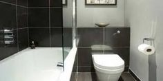 Small monochrome bathroom - Go for a black, white and grey colour scheme to get that hotel-chic look in a small bathroom. Here, black bathroom tiles add definition to the soft grey walls, and a glass shower screen gives the illusion of more space - ideal New Bathroom Ideas, Bathroom Photos, Simple Bathroom, Bathroom Interior, Modern Bathroom, Bathroom Black, Master Bathroom, Bathroom Furniture, Bathroom Inspiration