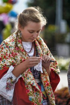 Girl in a scarf and an old Russian costume of the 19th century folk festivals Festival Slavic Circle Stock Photo