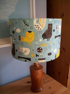 Handmade lampshade with Scandinavian or mid century inspired birds, owls and patterns in pale blue, mustard, black and white by EmporiumIllumination on Etsy https://www.etsy.com/listing/252028369/handmade-lampshade-with-scandinavian-or
