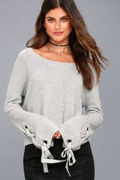 Fall in love this season with the Flirt and Finesse Light Grey Lace-Up Sleeve Sweater! Lace-up ties thread through silver grommets along the long, flaring sleeves of this cute, knit sweater. Ribbed knit accents the rounded neckline, sleeve cuffs, and slight, high-low hem for a cute and cozy look.