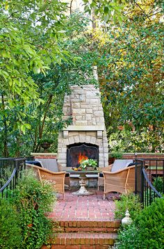 Outdoor Fireplace The property was landscaped with brick walks and patios that provide outdoor living spaces. Areas like this one by the fireplace increase opportunities for family entertaining.