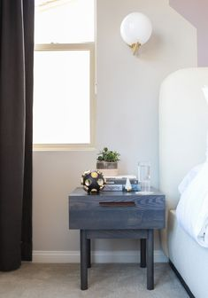 Side table Design Milk's master bedroom featuring Blu Dot Shale Bedside Tables