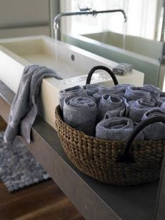 rolled peach and grey hand towels. When you're in a tiny apartment without a linen closet, you have to find alternative ways to store extra bath towels.
