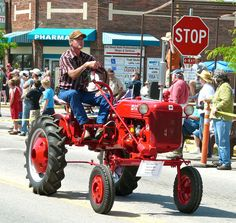 Antique tractor rolls down the street near the North Valley Public Library on Main Street at Western Heritage Days parade in Stevensville.