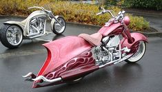 Not a fan on the pink one but in love with the style of the bike behind it. Paint it hot pink with Purple flames!