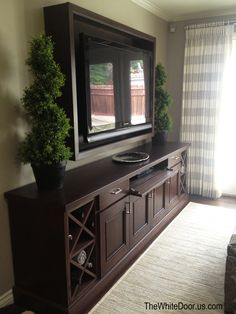 Custom entertainment center and framed tv backdrop