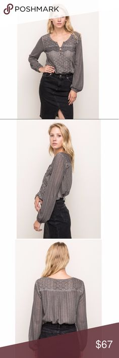 Mystree grey blouse This pretty grey lace panel mixed media blouse is perfect for work or going out. Comfortable, blousy fit and long enough to tuck into skirts and pants. The body is soft with pretty openwork detail and lace accents. Simple and chic! Mystree Tops Blouses