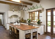 Spanish Hacienda kitchen. Love the openess and big island with seating and storage, love the windows. Need more counter space around edges.