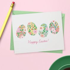 A boxed set of Easter cards featuring a hand painted illustration of floral eggs. Each card comes with your choice of pastel yellow or Kraft