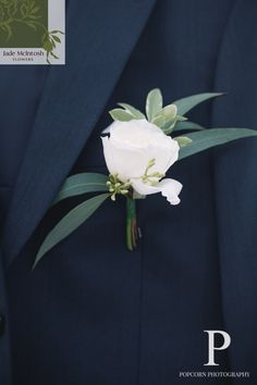 Can't beat the classics! Buttonhole of a single white rose and some foliage. A sprig of nutty gum adds texture. www.jademcintoshflowers.com.au www.popcornphotography.com.au