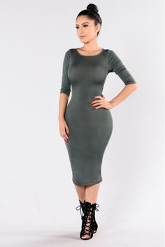 - Available in Black, Olive, and Camel - Fitted Dress - Long Midi Length - 3/4 Sleeve - Round Neckline - X Lace Up Back - Back Slit - Made in USA - 95% Polyester 5% Spandex
