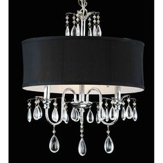 Give your living room a sophisticated finish by crowning it with this elegant shade and crystal chandelier. This chandelier has a sleek black shade complemented with a set of light catching crystals to amplify the luminance of its three lights.