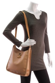 Love the understated Hermes details in this bag!