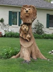 Tree stump carving of a Lion family