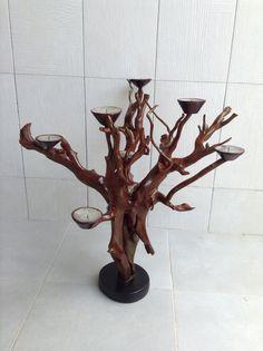 Driftwood candle holder hand made in Grand Bassam, Cote d' Ivoire. Designed by Artisans of Abidjan.