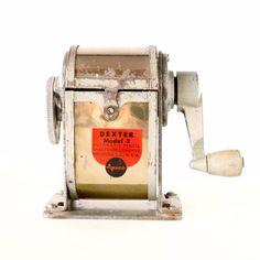 Vintage Dexter Pencil Sharpener Model 3 (c.1920s) - ThirdShiftVintage.com #Vintage #VintageDecor #VintageOffice #ThirdShiftVintage Pencil Shavings, 2 Pencil, Pencil Sharpener, Vintage Office Decor, Vintage Home Offices, Office Items, Dexter, A Table, 1920s