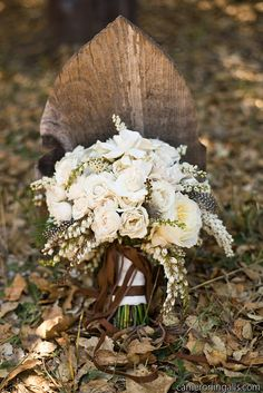 I really like this idea for my bouquet! Mostly ivory's with a little brown...