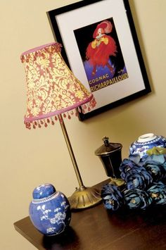 Give new life to a beat-up lamp shade with a quick fabric re-cover.
