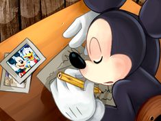 Mickey fell asleep while trying to finish his drawing.