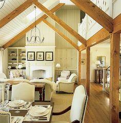 Traditional Great Room with Columns, Armonk 6-arm indoor/outdoor chandelier, High ceiling, Hardwood floors, Skylight