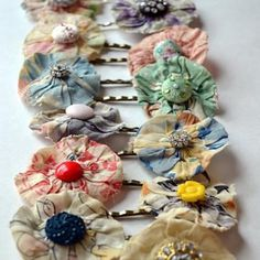 use vintage fabric yo-yo's and buttons to make these pretty bobby pins.  I don't have vintage yo-yo's but I do have plenty of vintage fabric to make some yo-yo's!