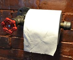 Offset your bathroom's girly decor with the bold look of the industrial pipe toilet paper holder.