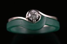 A twisted diamond singlestone has a wax model hand carved to fit against the natural lines of the engagement ring.