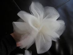Tulle flower. Would work nicely in cotton material with a plain white shirt, in a set of 3, upper left side like a corsage.