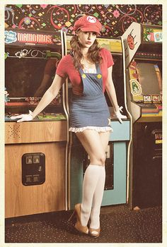 "Super Mario Sister next to a Nintendo arcade game. ""Mario Cosplay via Meagan.Marie at Flickr"