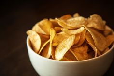 COMPLETELY WEIRD HOLIDAYS IN MARCH Ѽ March 14: National Potato Chip Day § Slightly less healthy than Popcorn Lover's Day. © Brzi/Getty Images