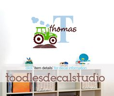 Tractor Wall Decal vinyl sticker set designed & made in the USA by Toodles Decal Studio. Choose (one) name and up to (four) 4 colors. { DIMENSIONS } x1 Initial is 16 tall x1 Name is 2.5 tall x1 Tractor is 10 x 14 Smoke and hill are also included. { HOW TO ORDER } please swipe photo to the left to see the color chart or click the right arrow. Please copy and paste the following info to the note to toodlesdecalstudio box when ordering: NAME: up to 4 COLORS: If no colors are selected the de...