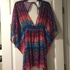 Jessica Simpson coverup Multi colored Jessica Simpson cover up - used very gently ! Buttons at the top of the back. Deep v and open back makes it super cute with your favorite bikini! Jessica Simpson Swim Coverups